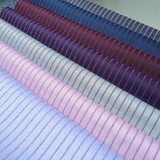 Shirting Fabric:180 to 200 gsm , 100% Cotton, 55% Cotton / 45% Polyester, Dyed, Plain