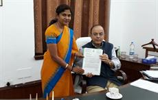 Tiruppur MP V Sathyabama handing over a letter requesting revision of GST rates to Union finance minister Arun Jaitley (seated); Courtesy: TEA