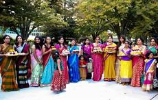 Women holding Bathukamma in their hands. Courtesy: Telangana government