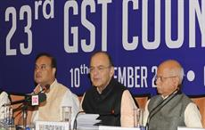 Indian finance minister Arun Jaitley (centre) addressing a press conference after the 23rd GST Council meeting in Guwahati. Courtesy: PIB