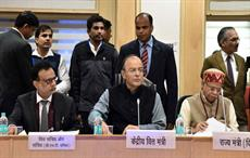 Union Minister for finance Arun Jaitley chairing the 25th GST Council meeting, flanked by minister of state for finance Shiv Pratap Shukla (right) and finance secretary Dr Hasmukh Adhia. Courtesy: PIB