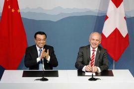 Mr. Li Keqiang & Mr. Ueli Maurer /abc.net.au