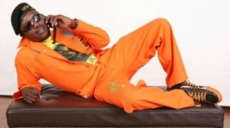 Model wearing Mugabe worksuit (New Zimbabwe)