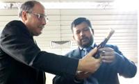 Mr Azouz(R) with Minister/news.lk