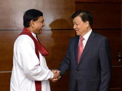Mr. Rajapaksa (L) and Mr. Yunshan (R)