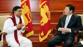 Mr. Rajapaksa (L); Mr Jianhua (R)