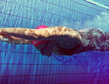Swimmer Sprenger breaks world record in Speedo swimsuit