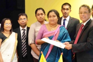 Mr. Jayaweera (R) and Ms. Mathrage (3rd from R)