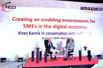 Mr. Jeff Bezos (L) with Mr. Kiran Karnik