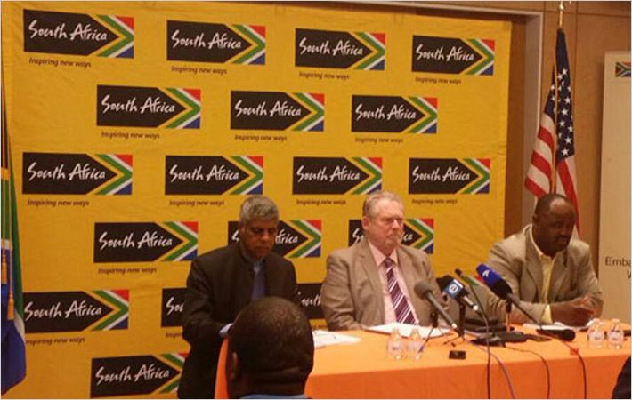 Rob Davies (centre) addressing media/Courtesy: The DTI