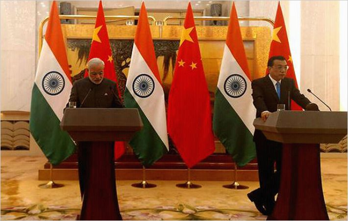 Narendra Modi (left) and Li Keqiang in Beijing/Courtesy: PIB
