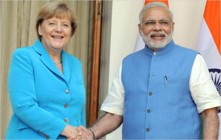 Narendra Modi (right) with Angela Merkel in New Delhi