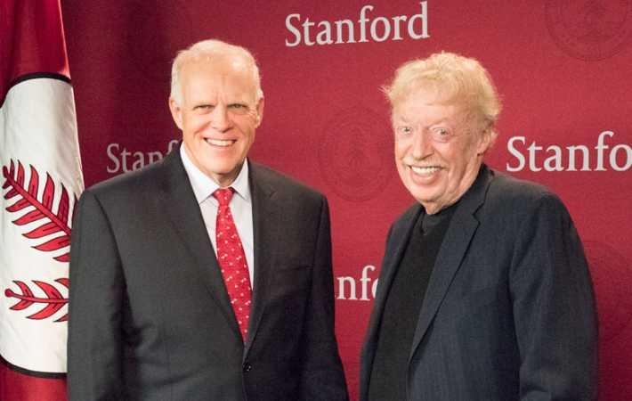 Stanford President John Hennessy and philanthropist Philip Knight.