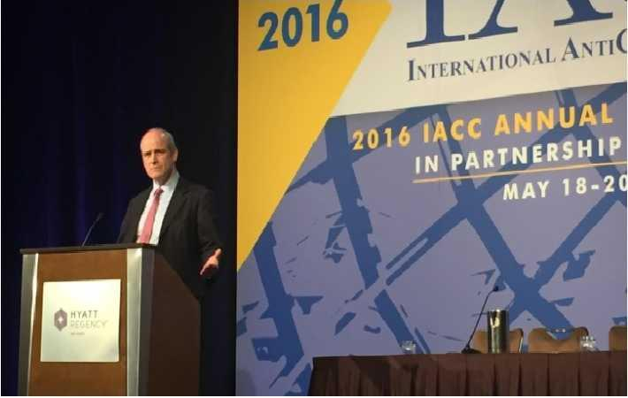 Michael Evans speaking at IACC annual meeting. Courtesy: Alizila