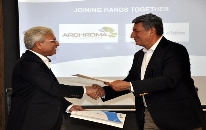 From left: Mujtaba Rahim, CEO, Archroma Pakistan, and Humayun Zafar, President Textile Institute of Pakistan, exchanging documents of the MoU