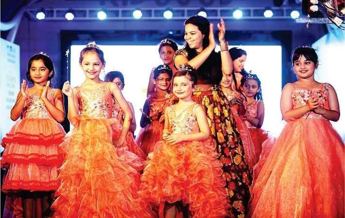 Designer Sakshi Bhala with the models in her collection at IKFS