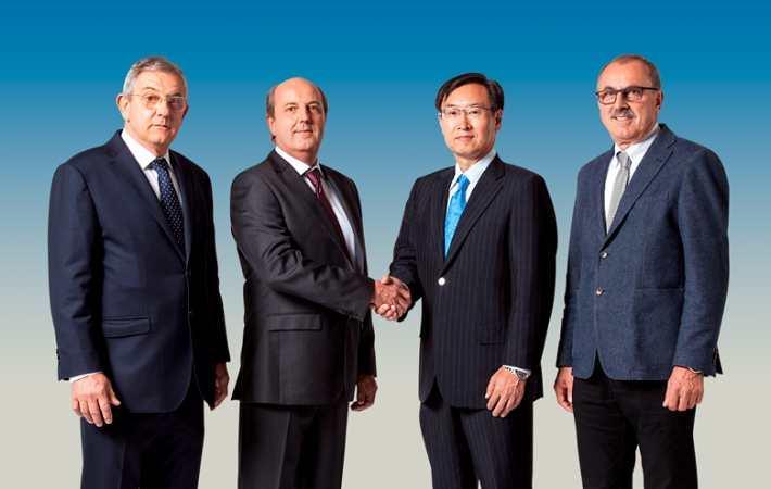Left to right: Sandro, Valerio Robustelli, Epson global president Minoru Usui and Riccardo Robustelli