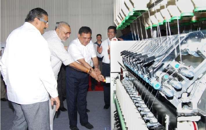 MSME minister Giriraj Singh inaugurating the machine as Sanjay Jayavarthanavelu, CMD, LMW, looks on.