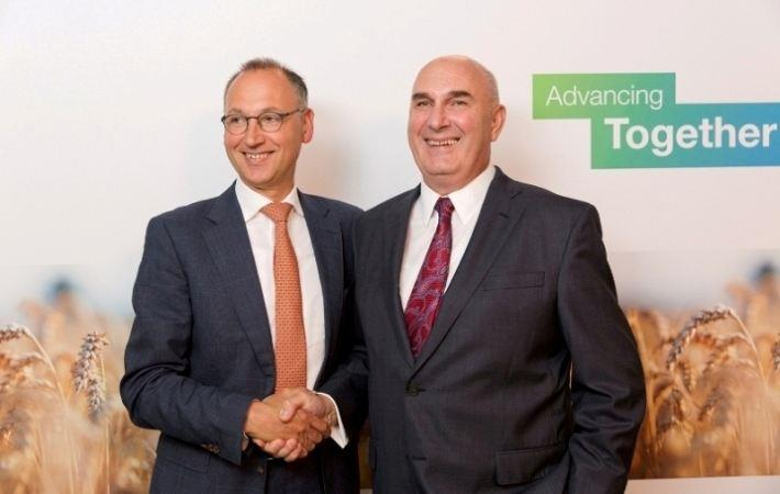 Werner Baumann (L), CEO of Bayer AG, & Hugh Grant, Chairman & CEO of Monsanto.