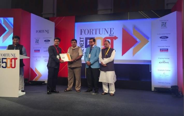 Nandan Denim CEO Deepak Chiripal receiving award from Union minister Nitin Gadkari