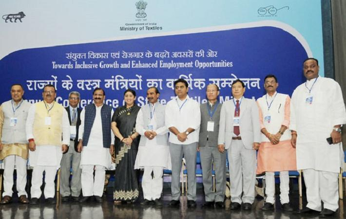 Union textiles minister Smriti Irani in a group photograph at the inauguration of the Annual Conference of the State Textiles Ministers in Delhi. Courtesy: PIB