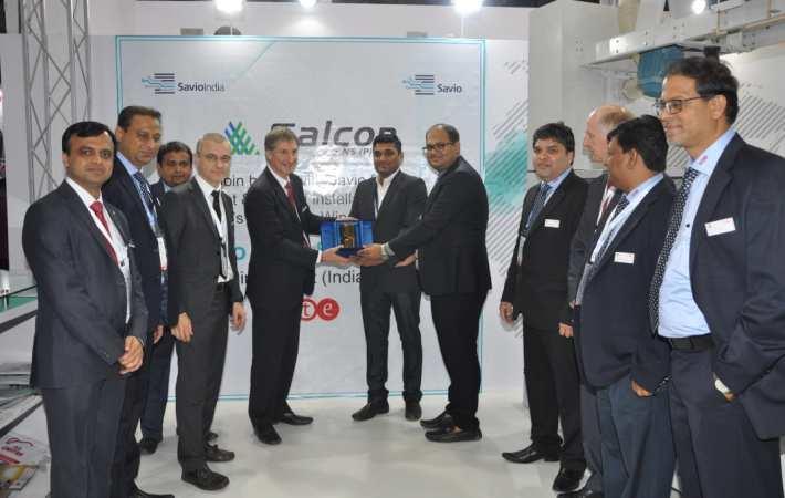 Falcon Yarns directors receiving the Golden Drum from Savio officials. Courtesy: Savio
