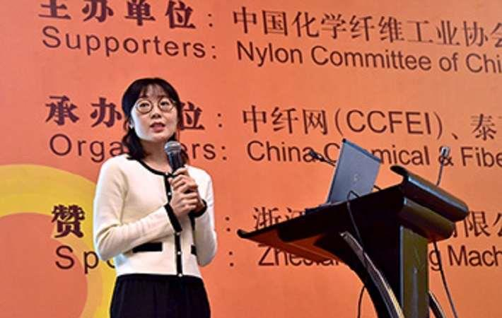 Huang Wei from Fiber Raw Material Dept of Sinopec Chemical Commercial Holding speaking at the Forum