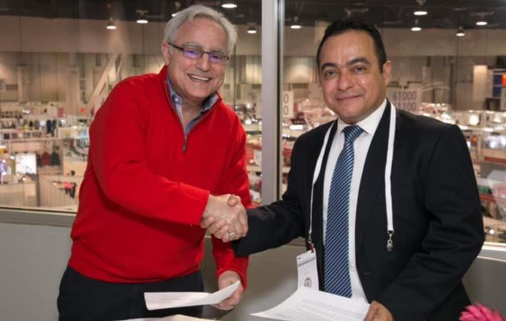 Rick Helfenbein (left), president and CEO of AAFA, with Juan Estrada, chief of party, Hub; Courtesy: Hub