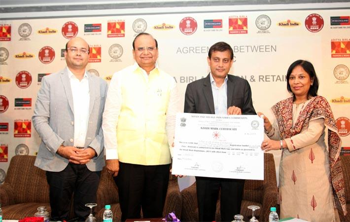 L-R Manish Singhai, COO, Peter England; Vinai Kumar Saxena, chairman, KVIC; Ashish Dikshit, business head, ABFRL and Anshu Sinha, CEO, KVIC while signing agreement. Courtesy: ABFRL