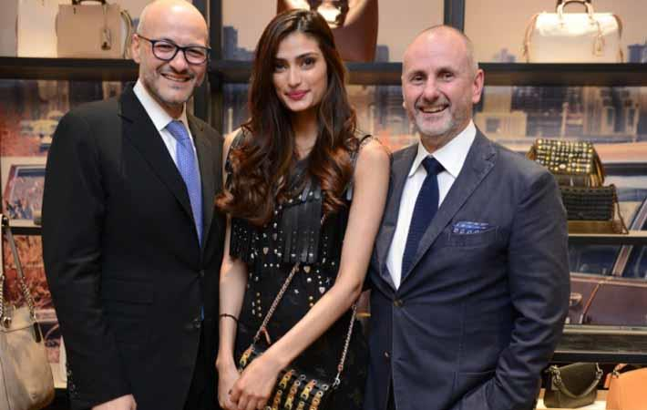 Courtesy: Victor Luis, CEO Coach; Athiya Shetty; Ian Bickley, Coach 1 at Coach store opening