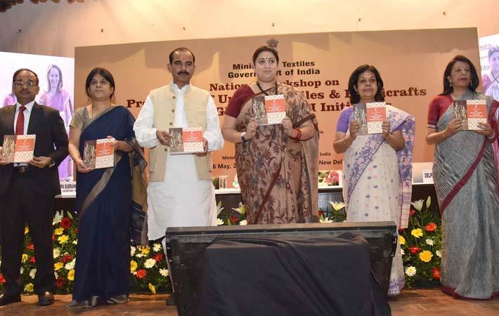 Textiles minister Smriti Irani at the inauguration of the National Workshop on Promotion of Unique Textiles & Handicrafts for GI & Post GI Initiatives with Ajay Tamta and Rashmi Verma. Courtesy: PIB