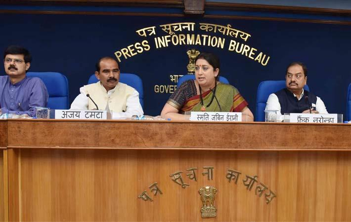 Textiles minister Smriti Irani at a press conference with minister of state for textiles, Ajay Tamta, the principal director general (M&C), PIB, AP Frank Noronha and other dignitaries. Courtesy: PIB