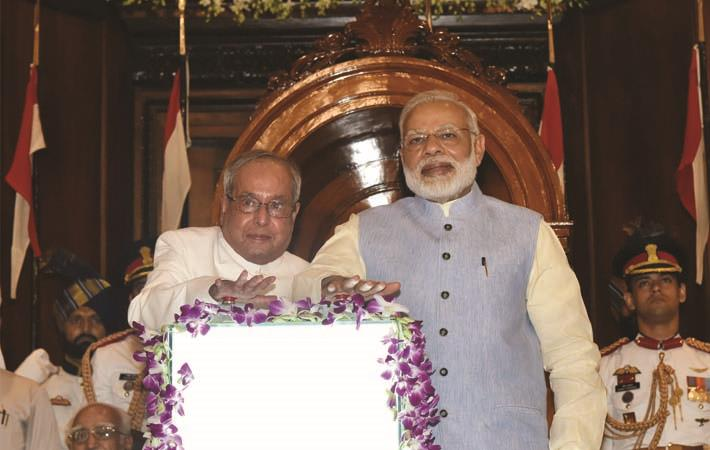 President Pranab Mukherjee and Prime Minister Narendra Modi pressing the buzzer to launch the Goods & Service Tax (GST), in Central Hall of Parliament, in New Delhi, in the midnight of June 30- July 0