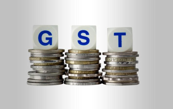 disadvantages of gst tax