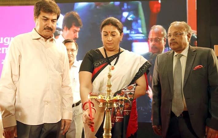 Textiles minister Smriti Irani lighting the lamp to inaugurate the 6th edition of the International Apparel and Textile Fair