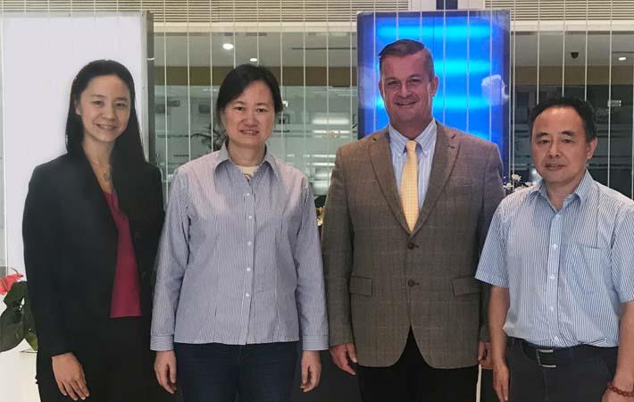 (l-r) Liu Yan, sales manager CNT Beijing, Zhou Ye Jun, president Wuxi No. 1 Cotton Mill,Thomas Sifrig, sales manager Loepfe, Joel Zou, import manager, Wuxi No. 1 Cotton Mill. Courtesy: Loepfe