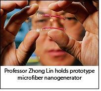 Professor Zhong Lin holds prototype microfiber nanogenerator