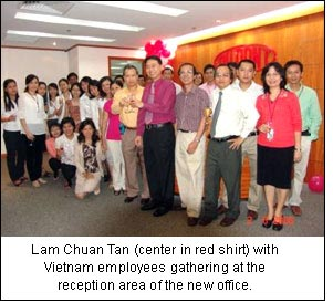 Lam Chuan Tan (center in red shirt) with Vietnam employees gathering at the reception area of the new office.