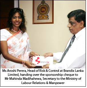 Ms Aroshi Perera,  Head of Risk & Control at Brandix Lanka Limited, handing over the sponsorship cheque to Mr Mahinda Madihahewa, Secretary to the Ministry of Labour Relations & Manpower