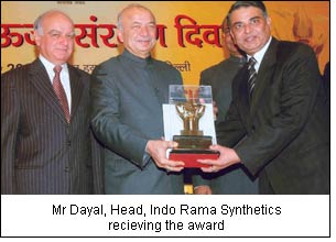 Mr Dayal, Head, Indo Rama Synthetics recieving the award