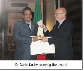 Dr Darlie Koshy receving the award