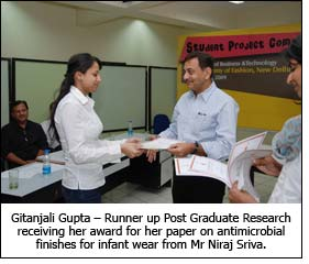Gitanjali Gupta – Runner up Post Graduate Research receiving her award for her paper on antimicrobial finishes for infant wear from Mr Niraj Sriva.