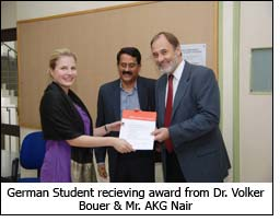 German Student recieving award from Dr. Volker Bouer & Mr. AKG Nair