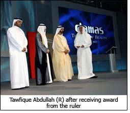 Tawfique Abdullah (R) after receiving award from the ruler