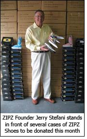 ZIPZ Founder Jerry Stefani stands in front of several cases of ZIPZ Shoes to be donated this month.
